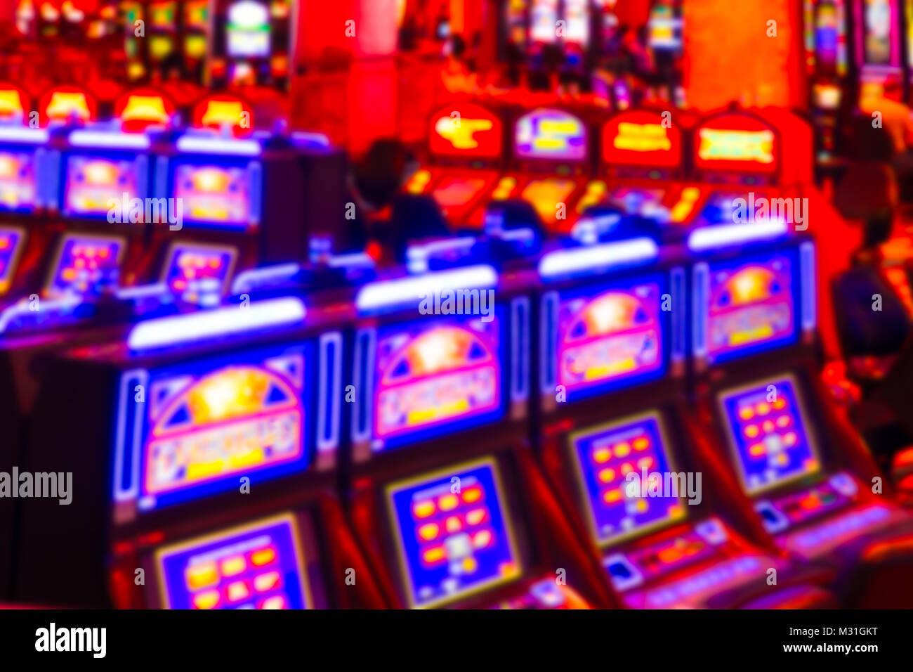 Defocused blur of gambling slot machines in casino - Stock Image