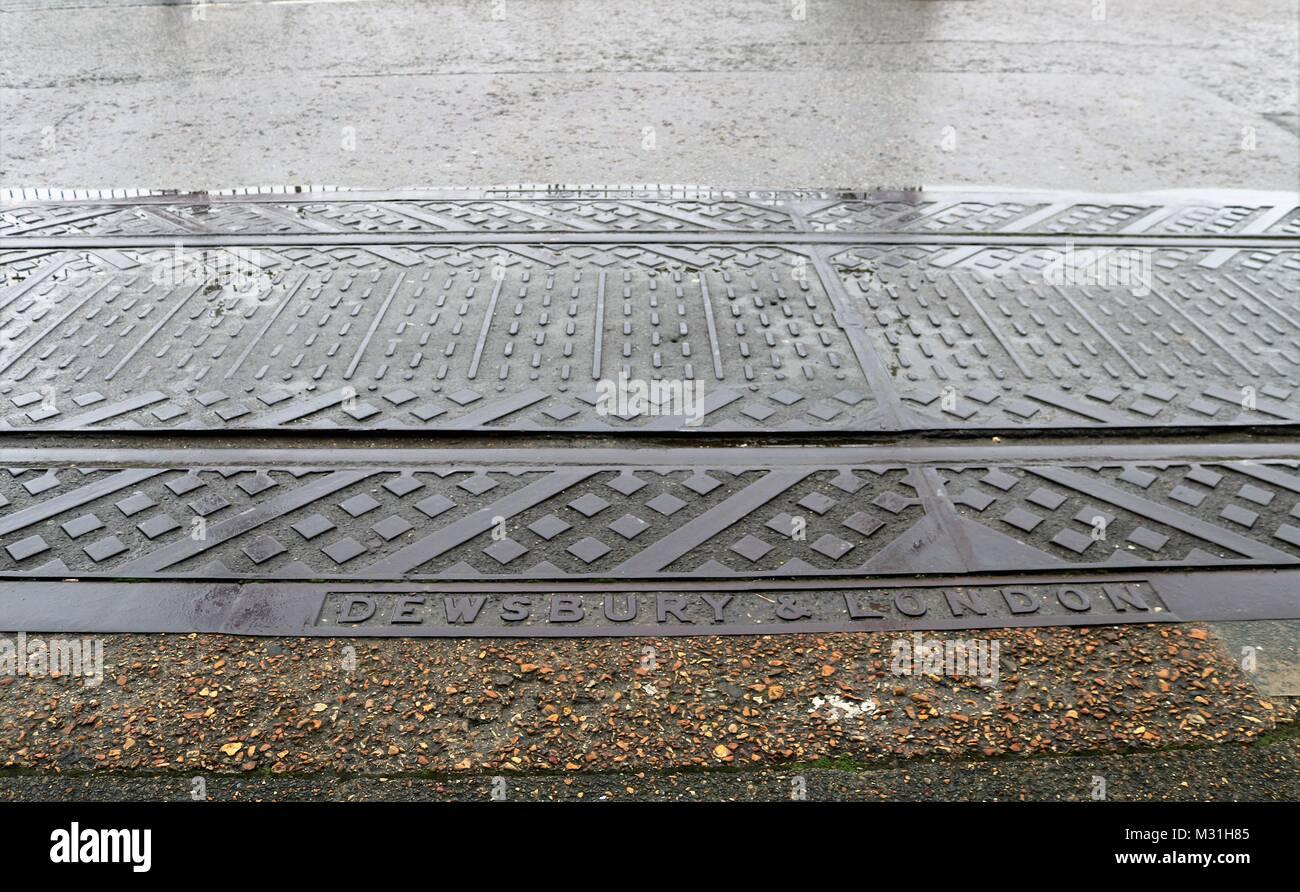 Dewsbury & London drain cover at Portsmouth Historical Dockyard, UK - Stock Image
