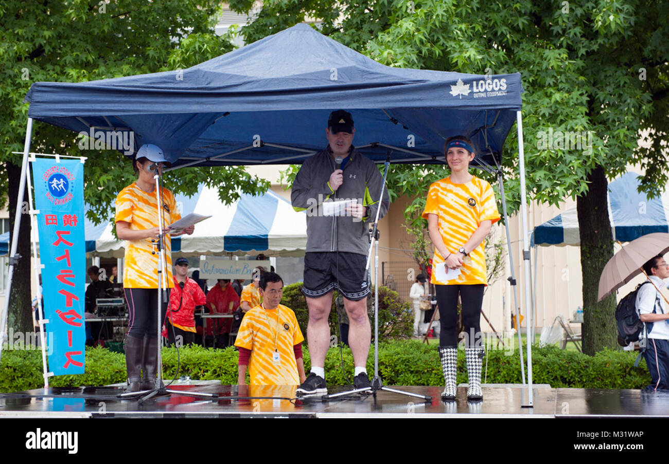 Col. Mark August, 374th Airlift Wing commander, welcomes runners at the Ekiden opening ceremony June 8, 2014, at - Stock Image
