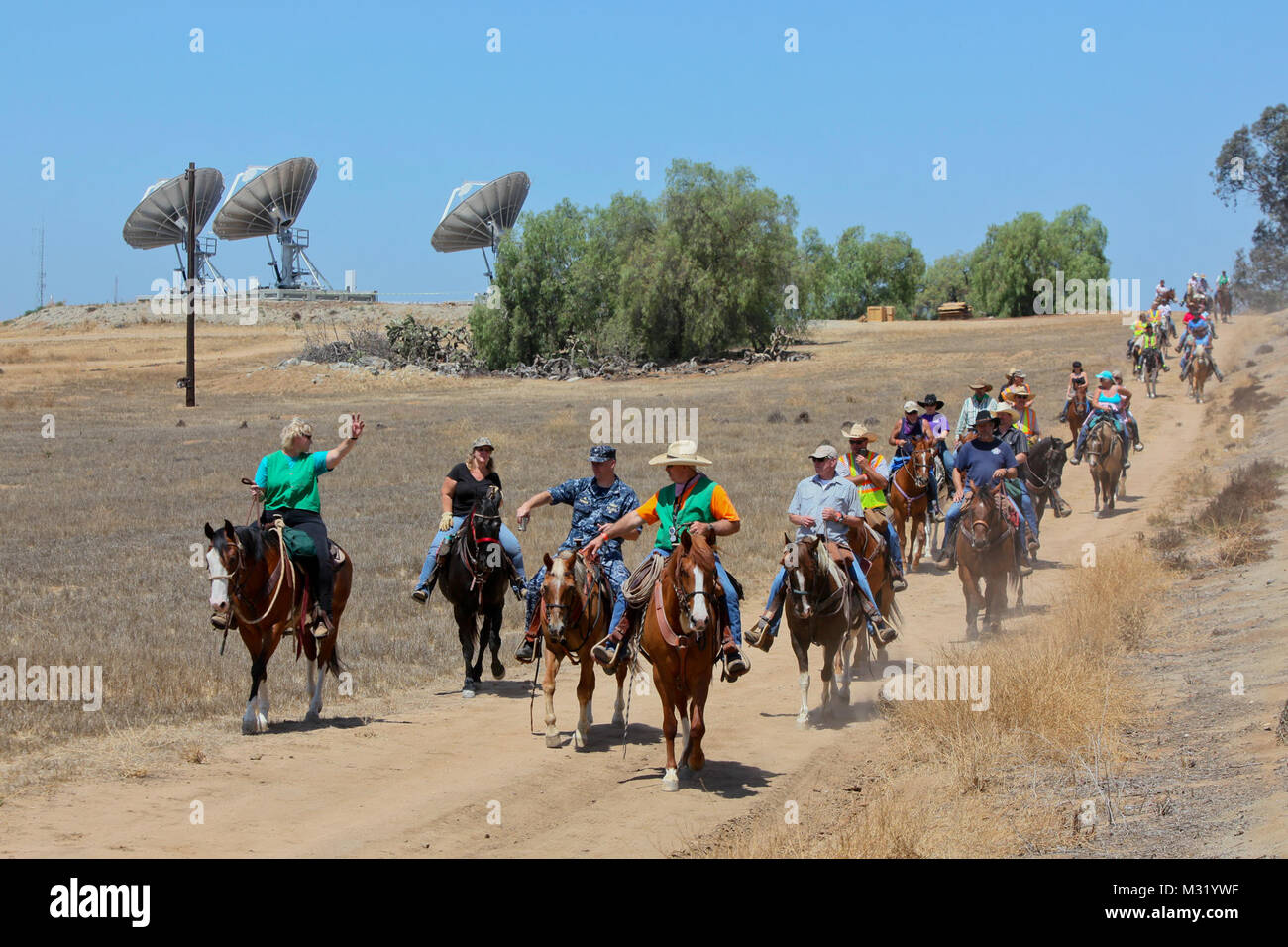 130622-N-HP195-672 NORCO, Calif. (June 22, 2013) Dozens of Norco's Saddle Sore Riders follow a dirt road toward - Stock Image