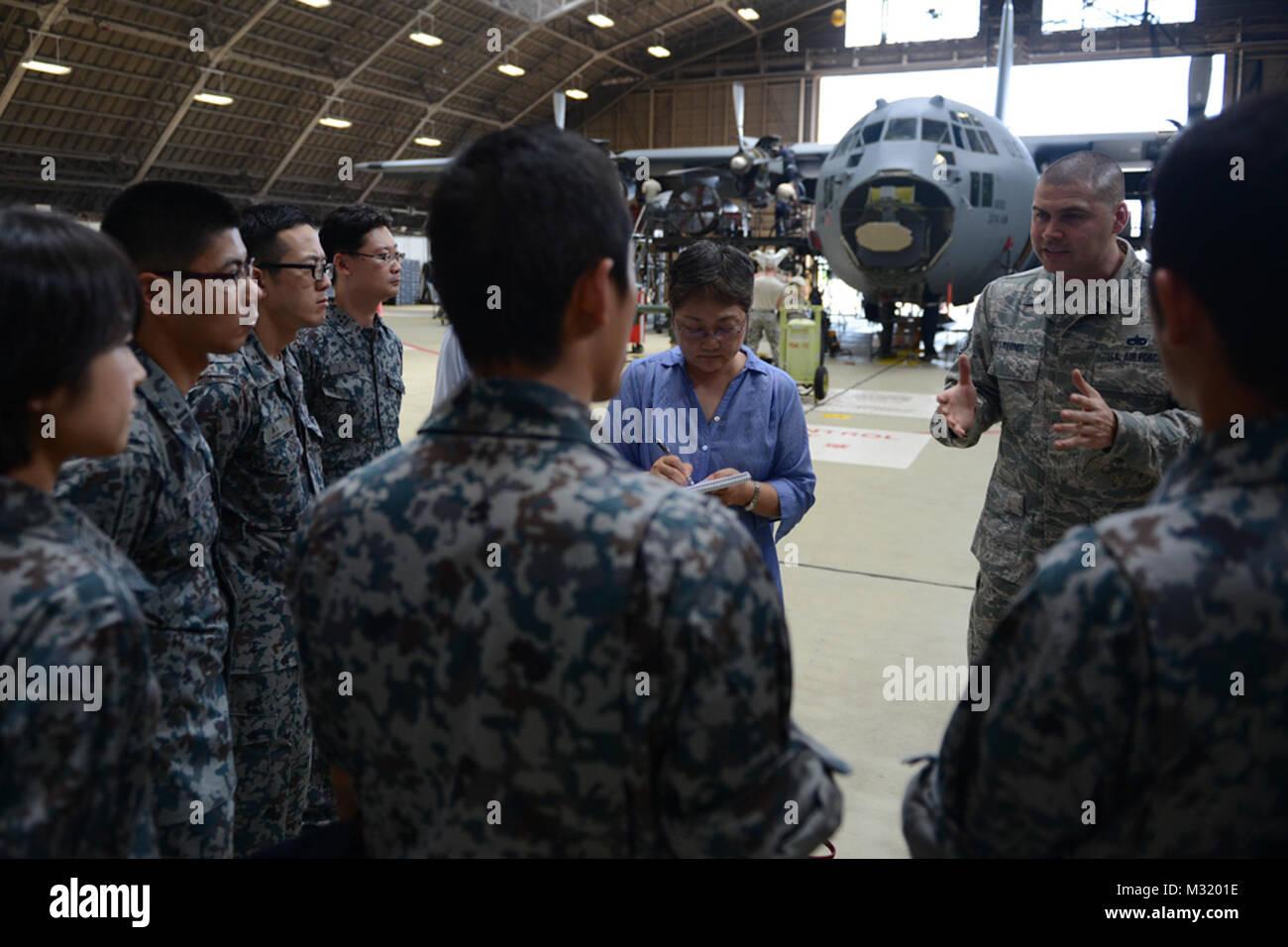 YOKOTA AIR BASE, Japan -- Tech. Sgt. Raul Torres, 374th Maintenance Squadron isochronal dock chief, explains when - Stock Image