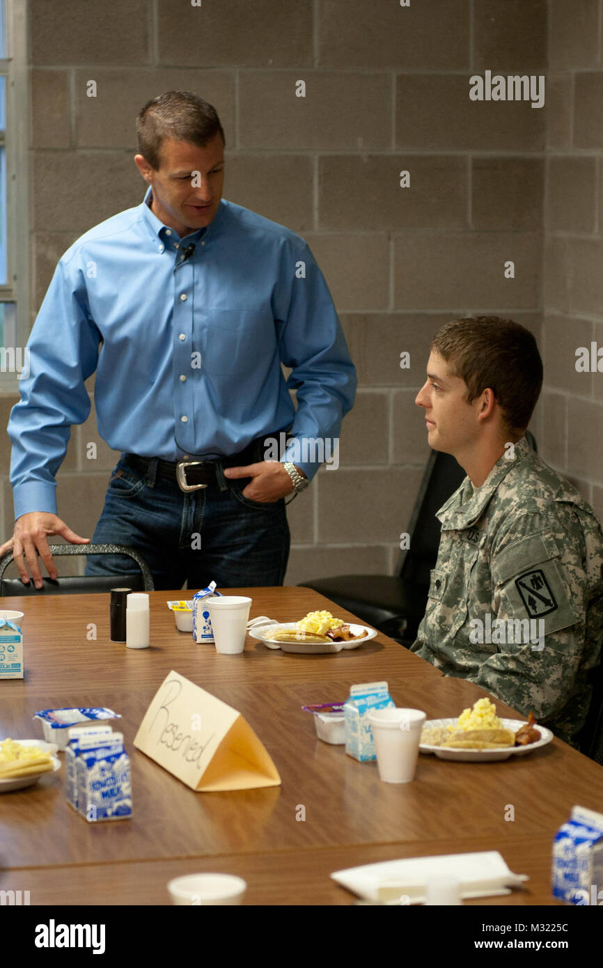 Oklahoma Congressman Markwayne Mullin speaks with Spc. Chris Rochell, of Duncan, Okla., a member of the 1st Battalion, Stock Photo