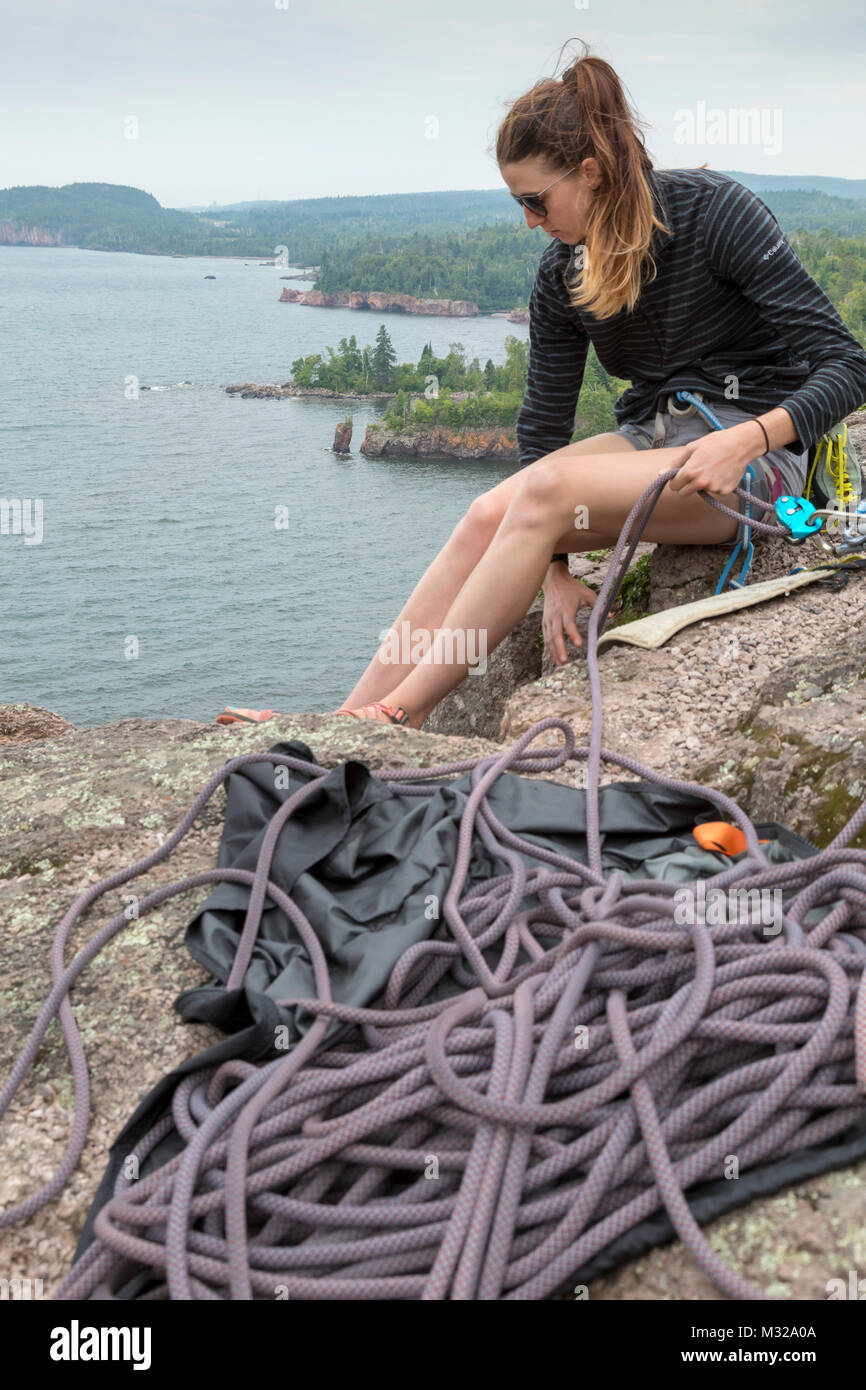 Silver Bay, Minnesota - Rock climbing above Lake Superior at Shovel Point in Tettegouche State Park. - Stock Image