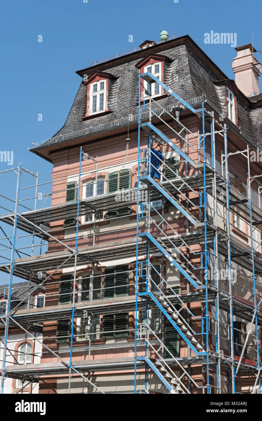 Detailed picture of a castle renovation with scaffolding framework - Stock Image