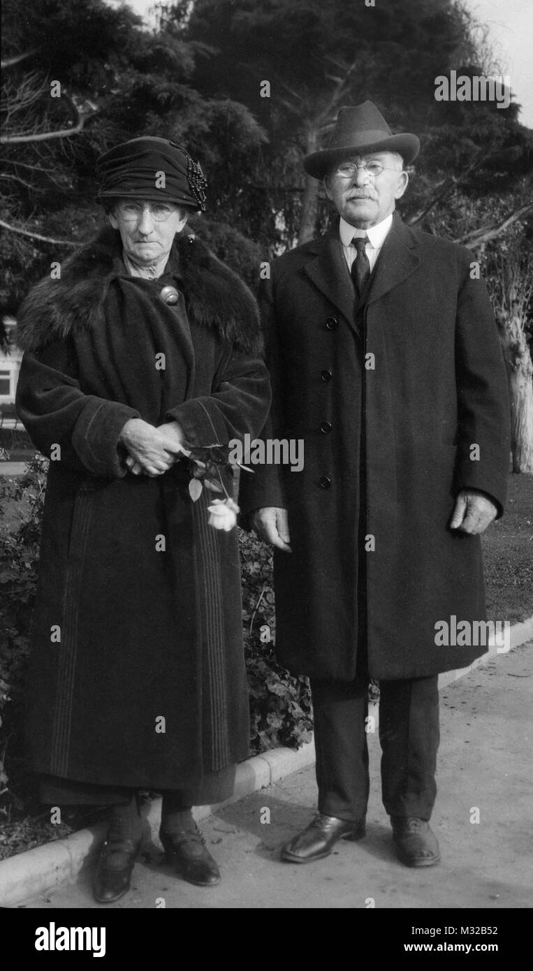 Senior couple stand together for portrait, ca. 1928. - Stock Image