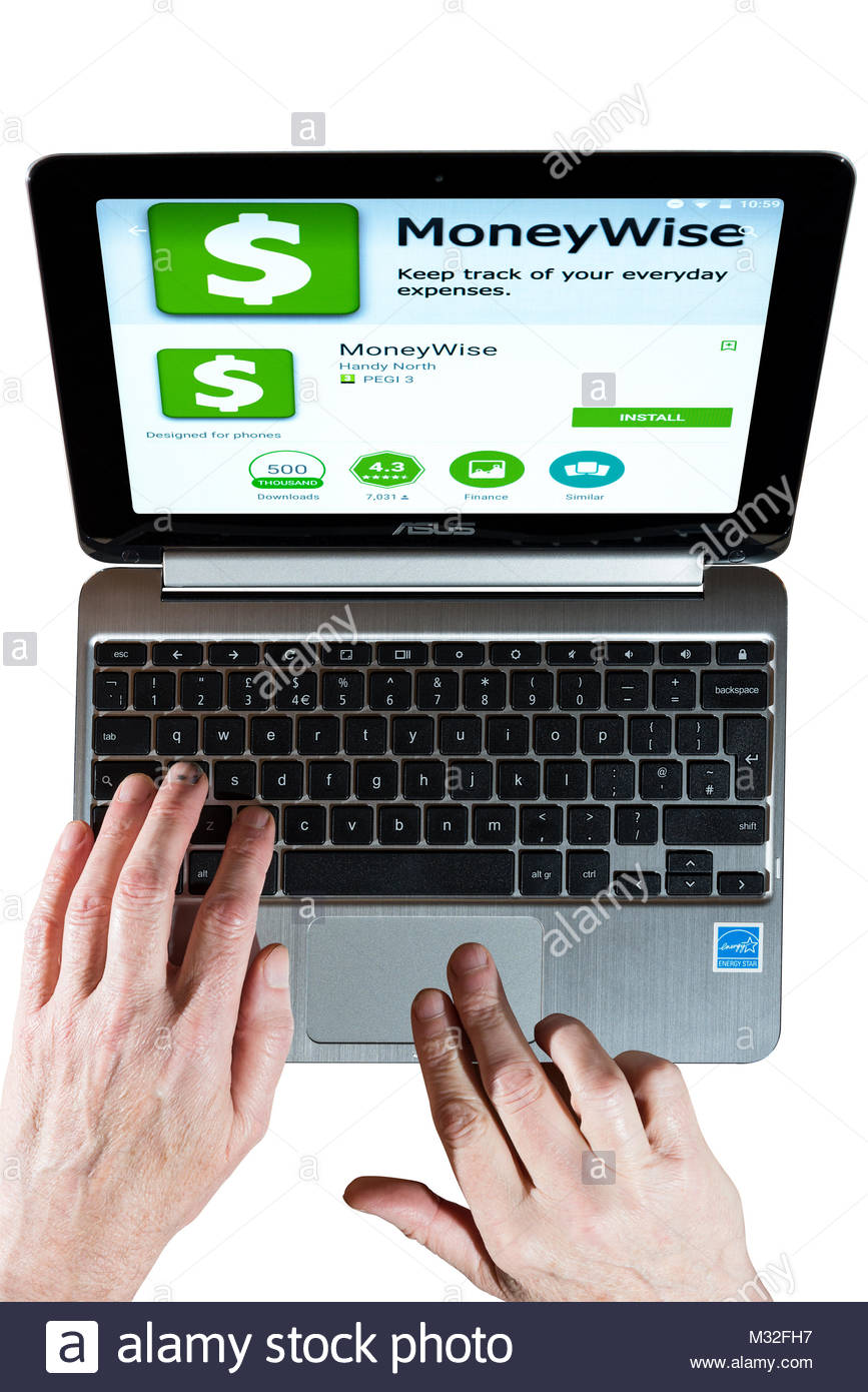 Moneywise app on a Chromebook screen with a man using the keyboard. Cut out on white background, Dorset, England. - Stock Image