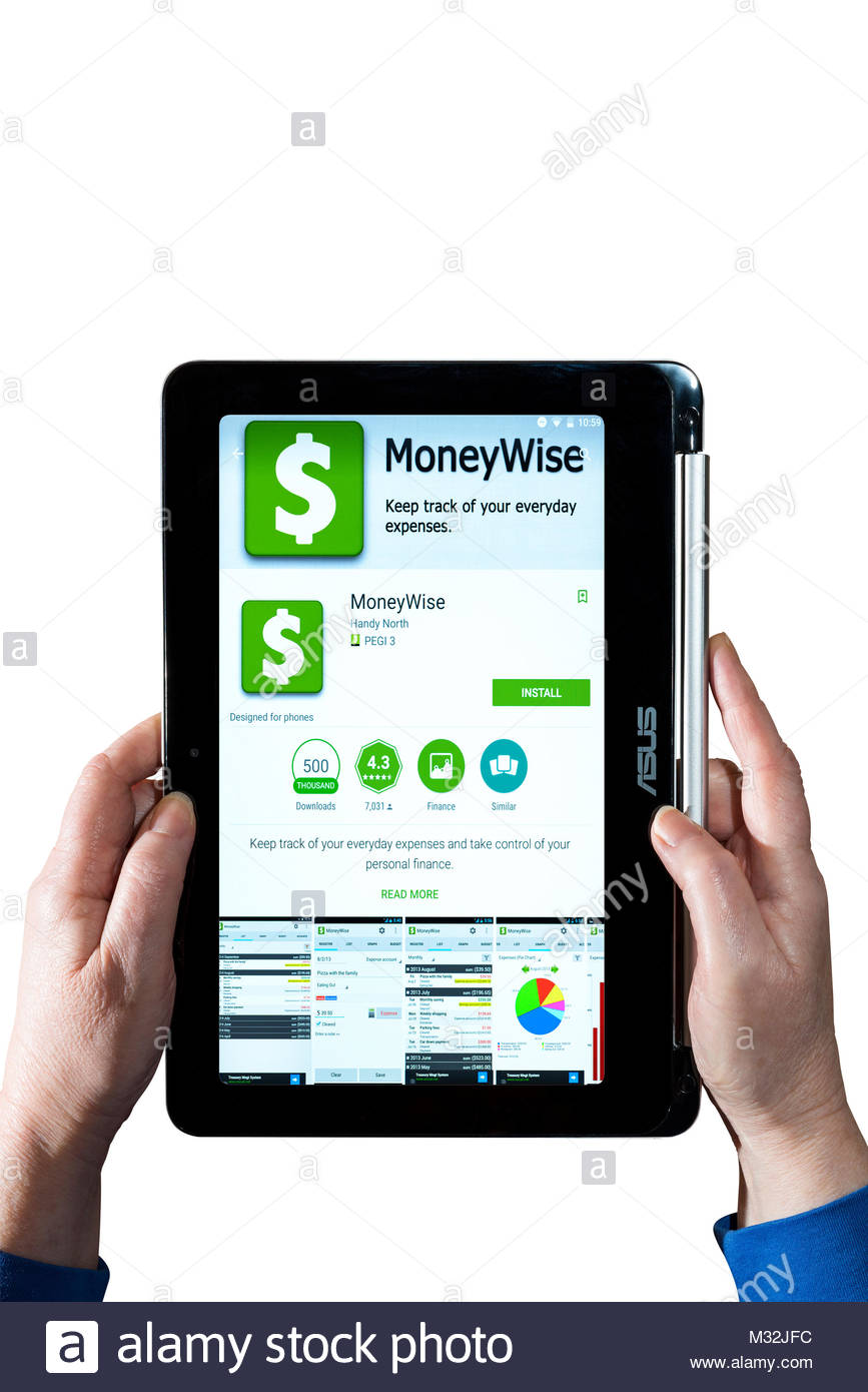 Moneywise app being used by a woman holding a Chromebook. Cut out on white background, Dorset, England - Stock Image