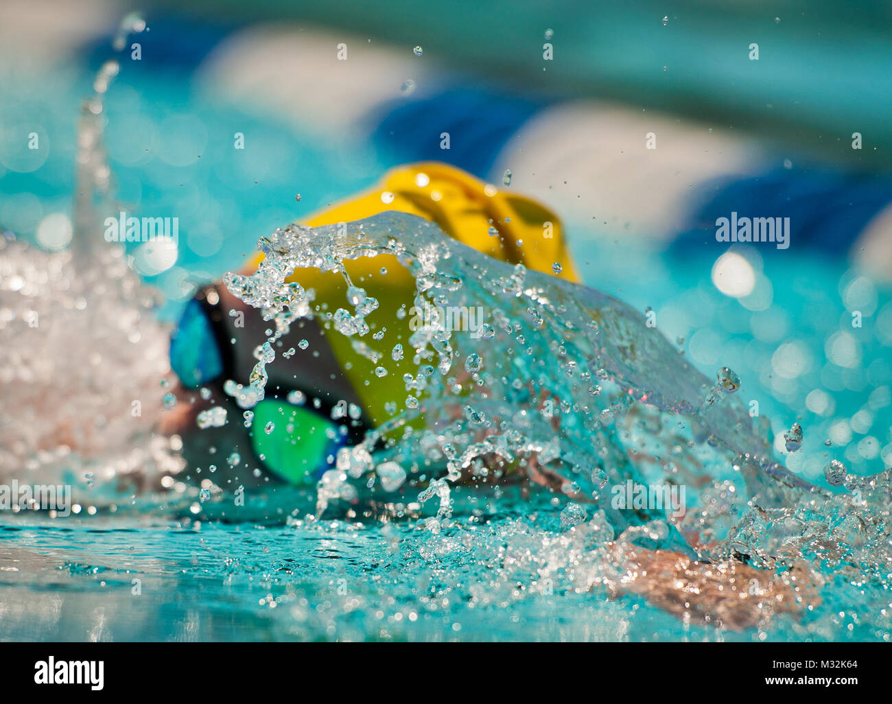Hanna Stulberg, a Warrior CARE attendee, swims laps during an afternoon training session at the adaptive sports - Stock Image
