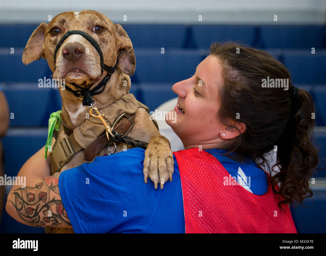 Hanna Stulberg, a Warrior CARE attendee, and her service dog, Valhalla, share a moment during the adaptive sports - Stock Image