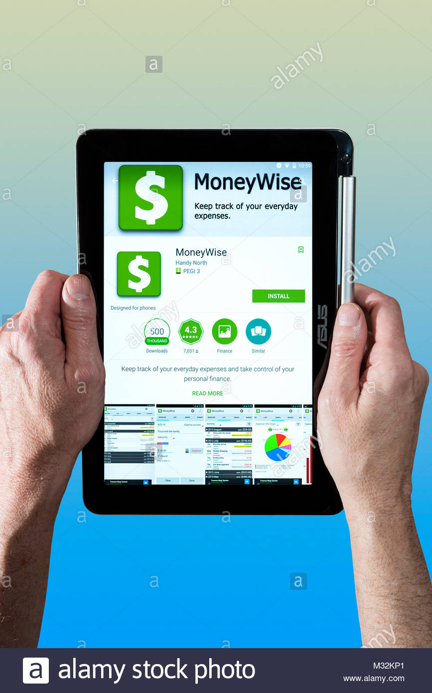 Moneywise app being used by a man holding a Chromebook. Cut out on coloured background, Dorset, England - Stock Image