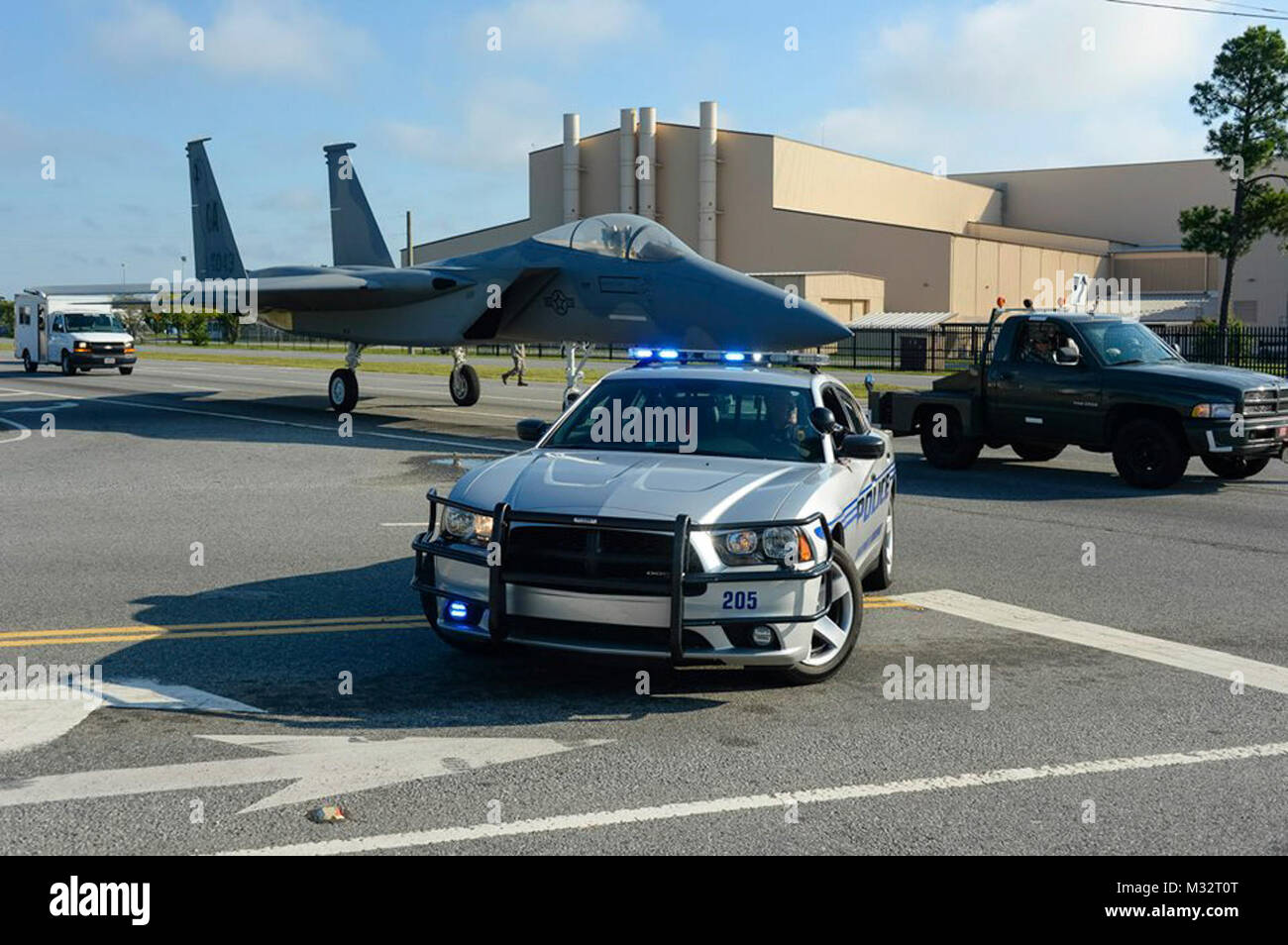 Lt. Jeff McCommon, with the Warner Robins Police Department, blocks traffic as Airmen from the 116th Maintenance - Stock Image