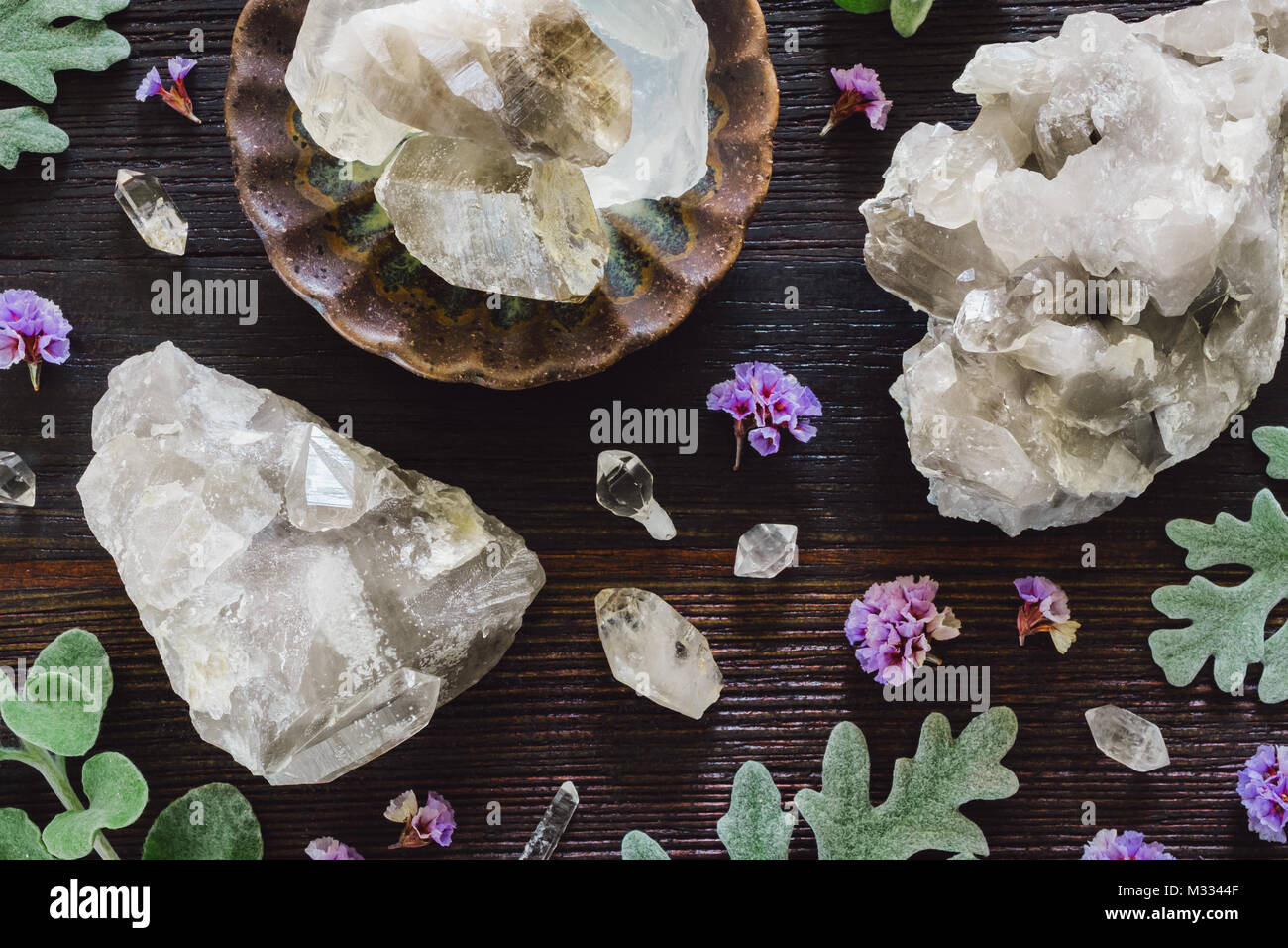 Quartz Crystal Clusters with Quartz Points on Dark Table - Stock Image