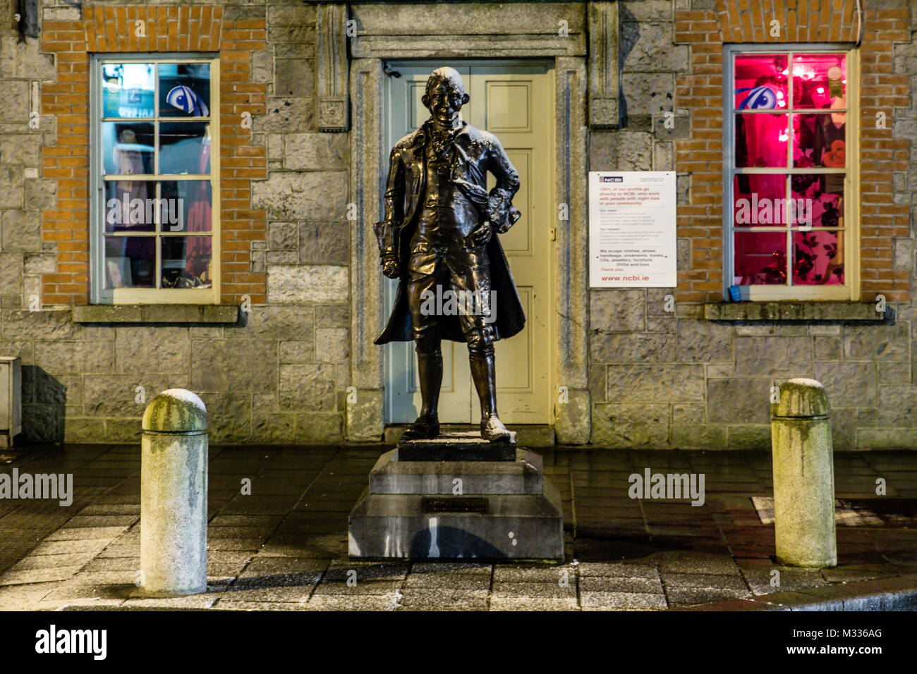 Brushed by light snow Arthur Guinness statue erected in 2013 in his hometown Celbridge in County Kildare, Ireland. - Stock Image