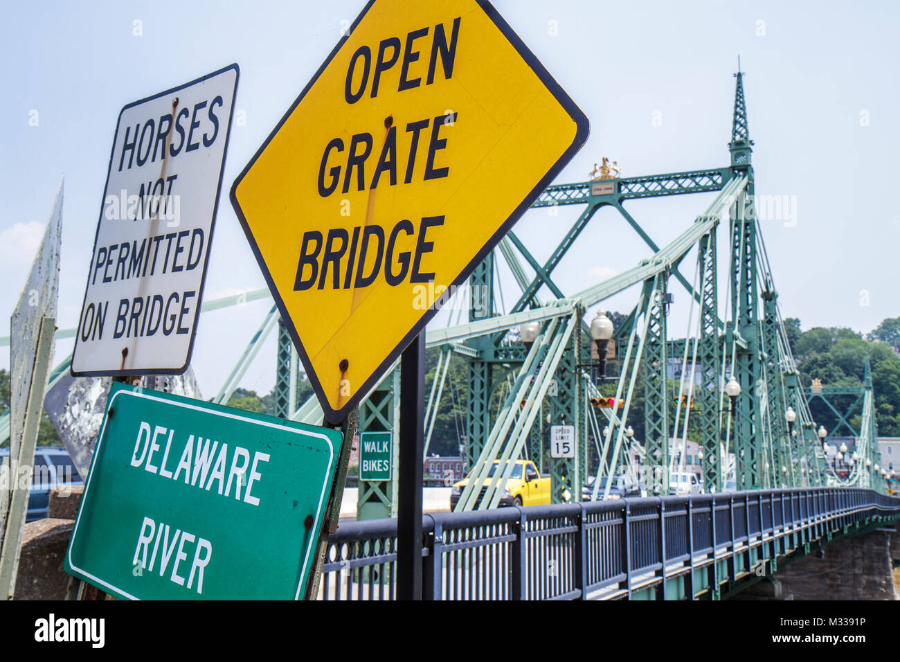 Pennsylvania Easton Delaware River Northampton Street Bridge historic traffic signs open grate horses not permitted - Stock Image