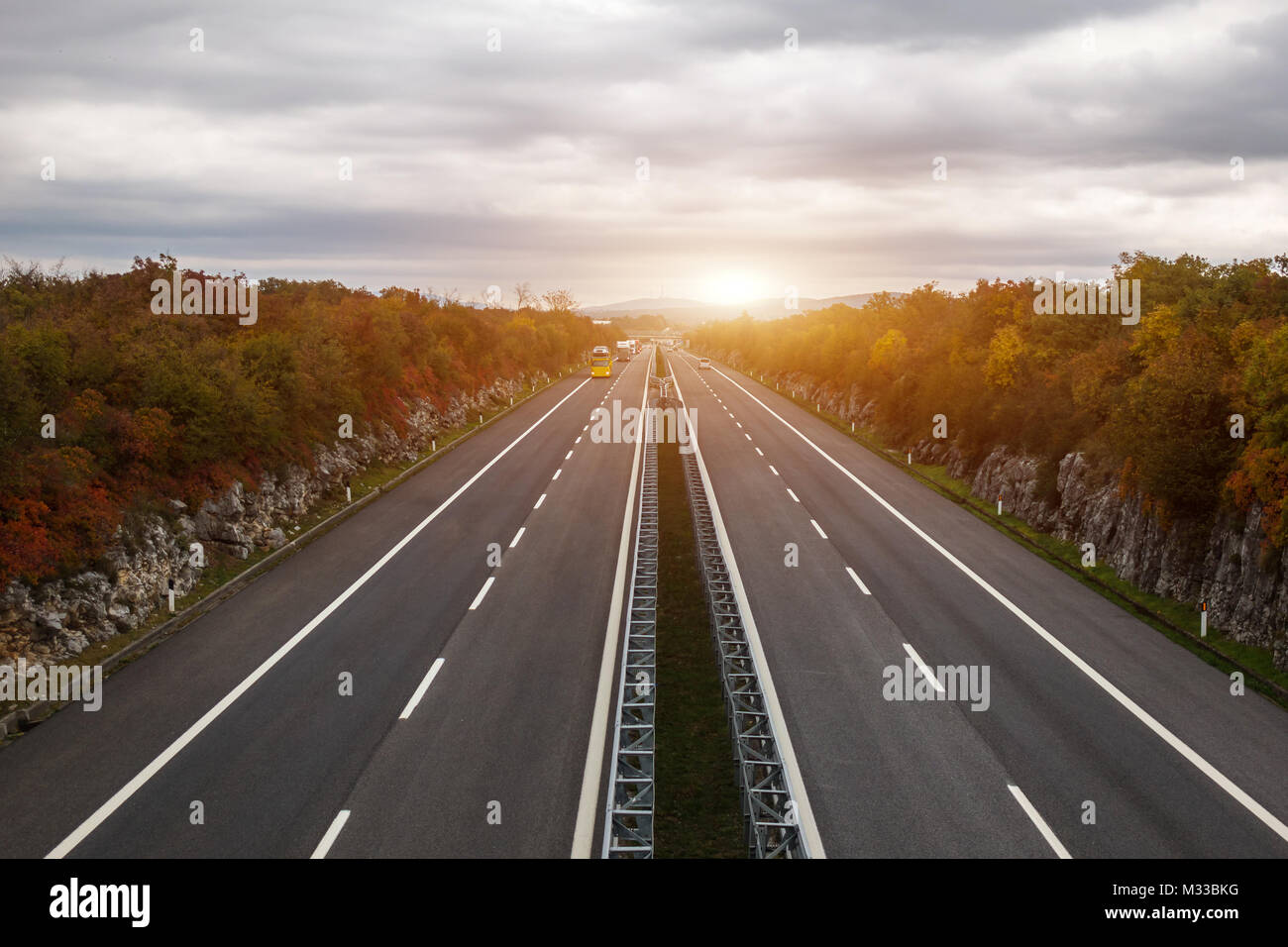 Sunrise on the highway  Transportation and traffic concept Stock