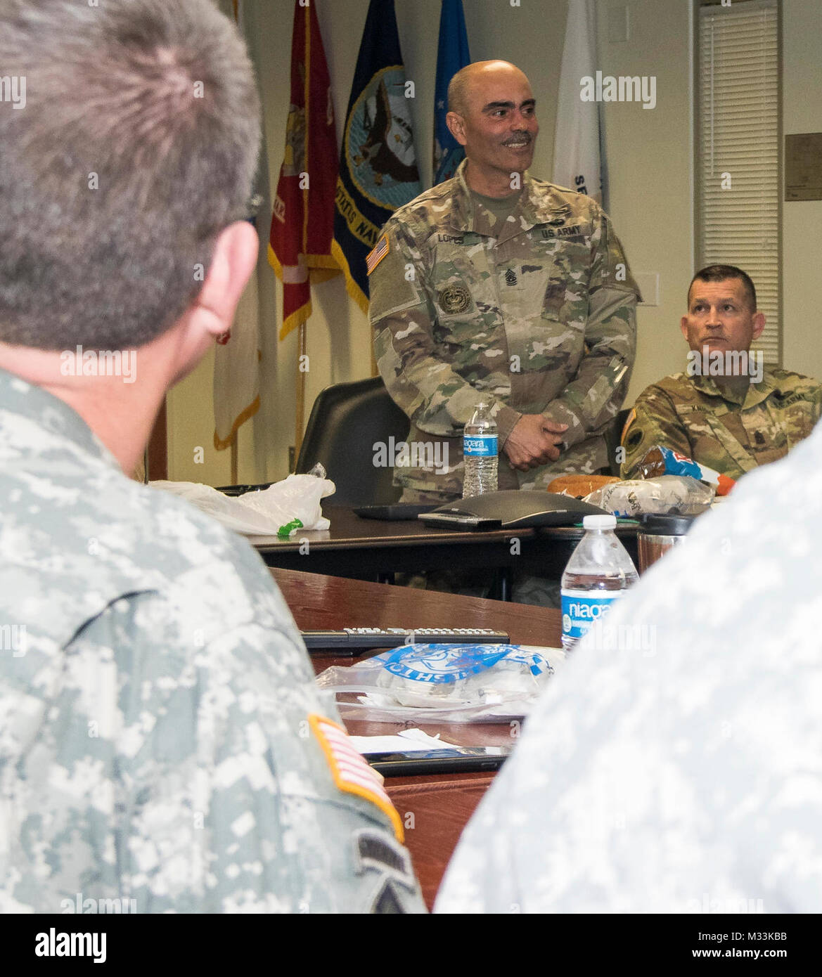 U.S. Army Command Sgt. Maj. Carlos O. Lopes, command sergeant major, 143d Sustainment Command (Expeditionary), speaks - Stock Image
