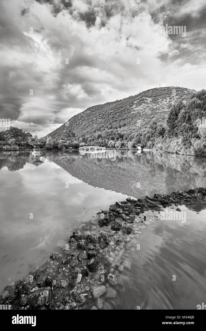 Black and white picture of the Jade Spring Park in Lijiang, China. - Stock Image