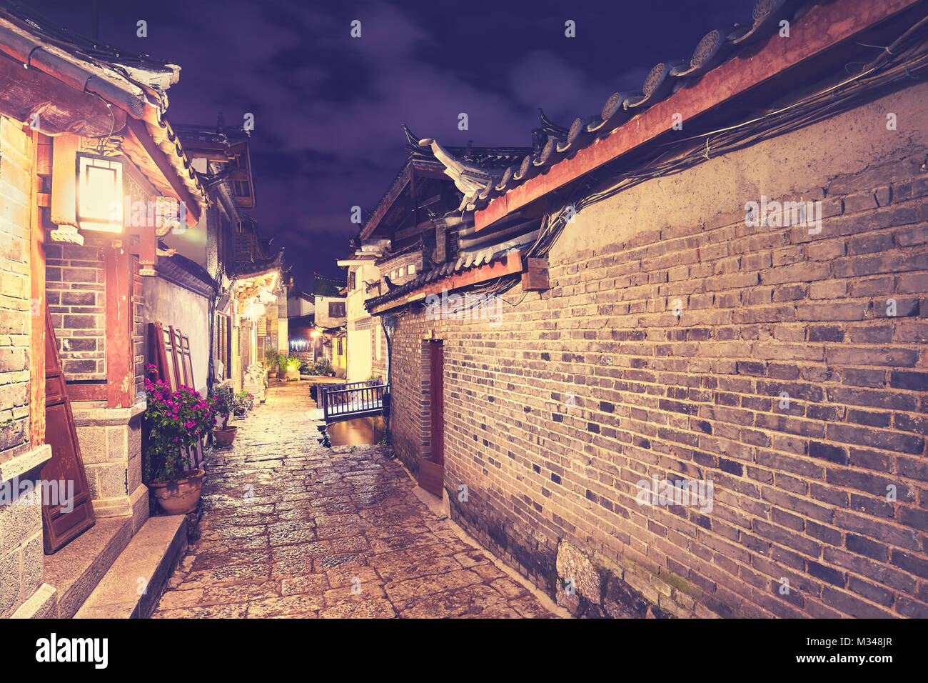 Color toned picture of the Old town of Lijiang at night, China. - Stock Image
