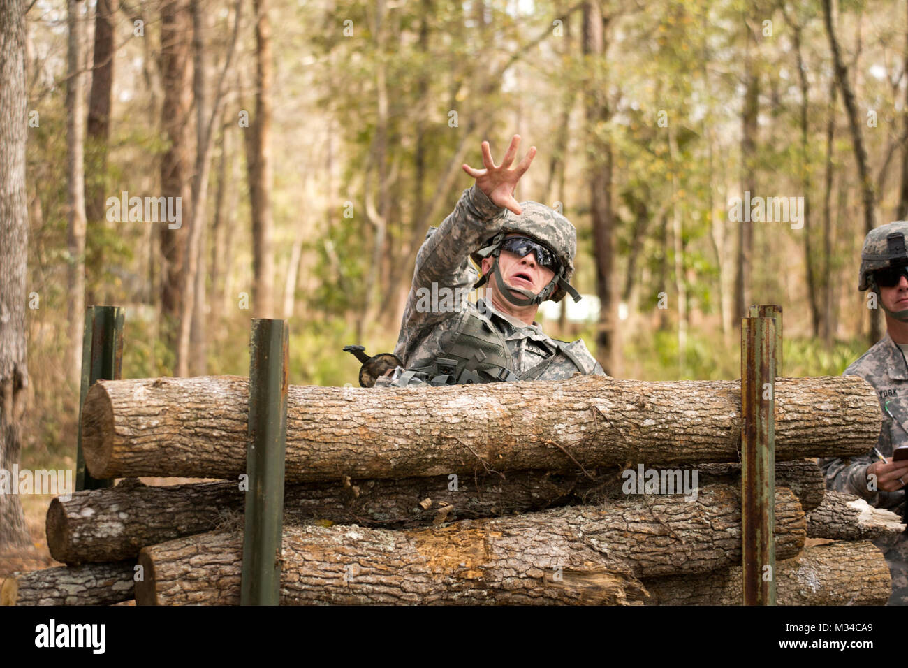 Face off – (GEORGIA GARRISON TRAINING CENTER, Ft. Stewart, Ga. 5 Mar. 2015) - Spc. Caleb DeLong lobs a grenade as part of his defensive movement under direct fire during the Georgia Army National Guard's 2015 Best Warrior Competition.  The competition, held at the Georgia Garrison Training Center at Ft. Stewart, Ga. pits the best military professionals, enlisted and non-commissioned officer, the Georgia Army National Guard has to offer challenging them physically, strategically and written.  (Georgia Department of Defense photo by Staff Sgt. Tracy J. Smith   released) Face off by Georgia Natio Stock Photo