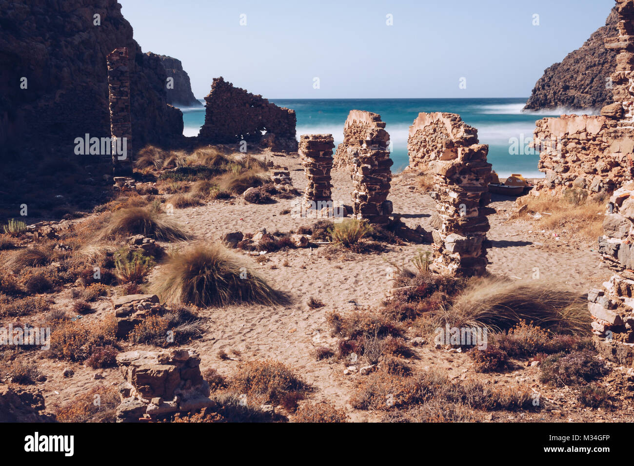 Long exposure of the beach of (Cala Domestica) with acient ruin  at the west coast of Sardinia. Italy. - Stock Image