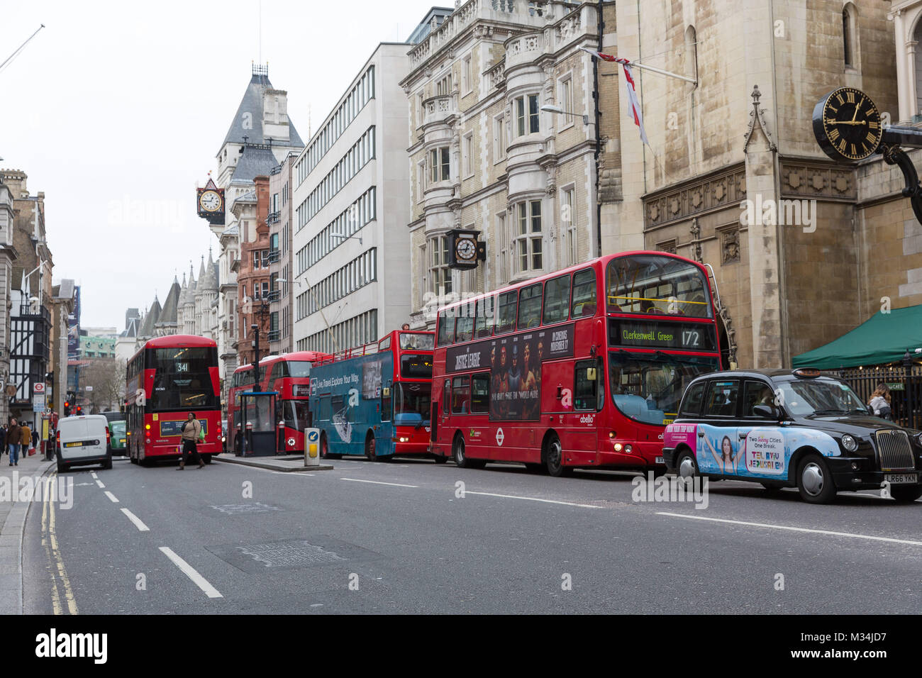 London, UK. 8th February 2018. Stationary buses and traffic in Fleet Street, London at lunchtime. Traffic pollution - Stock Image