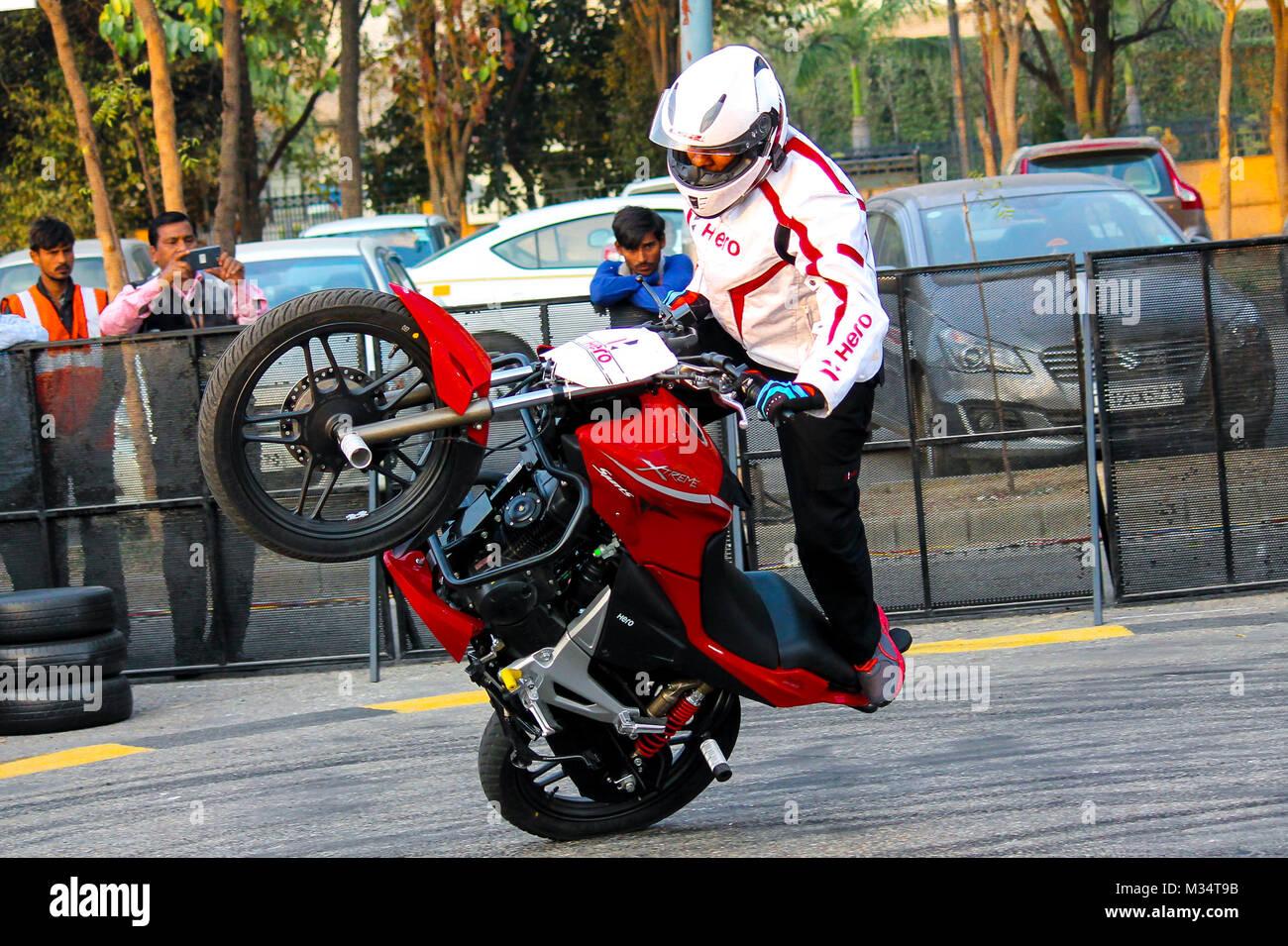 India Expo Mart, Noida, Utter Pradesh, India. 08th February, 2018. Hero Stunt man performing motor bike stunts in - Stock Image