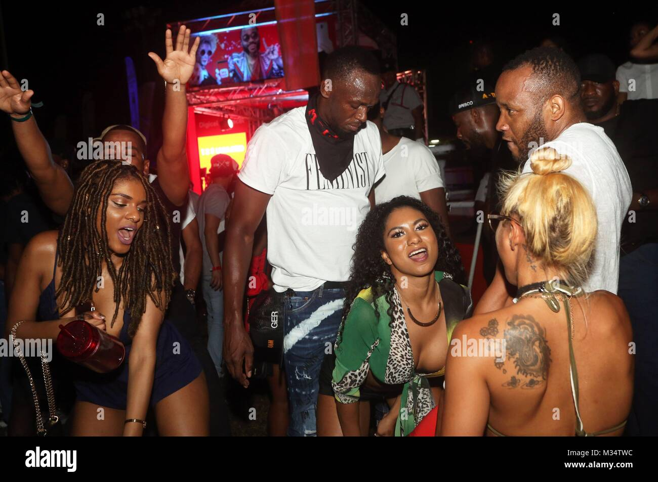 Jamaican ex-athlete Usain Bolt (3-L) dances at the Tribe's Ignite party held as part of Trinidad and Tobago - Stock Image