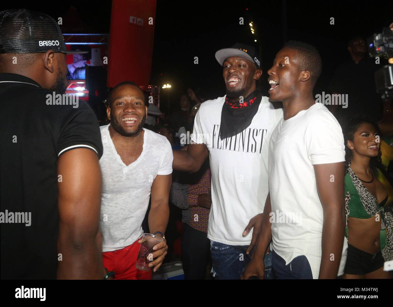 Jamaican ex-athlete Usain Bolt (C) dances at the Tribe's Ignite party held as part of Trinidad and Tobago carnival - Stock Image