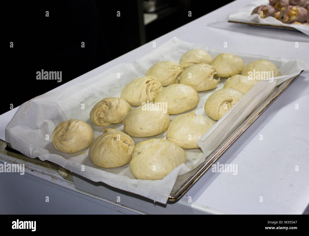 Steam buns from yeast wheat dough on tray - Stock Image