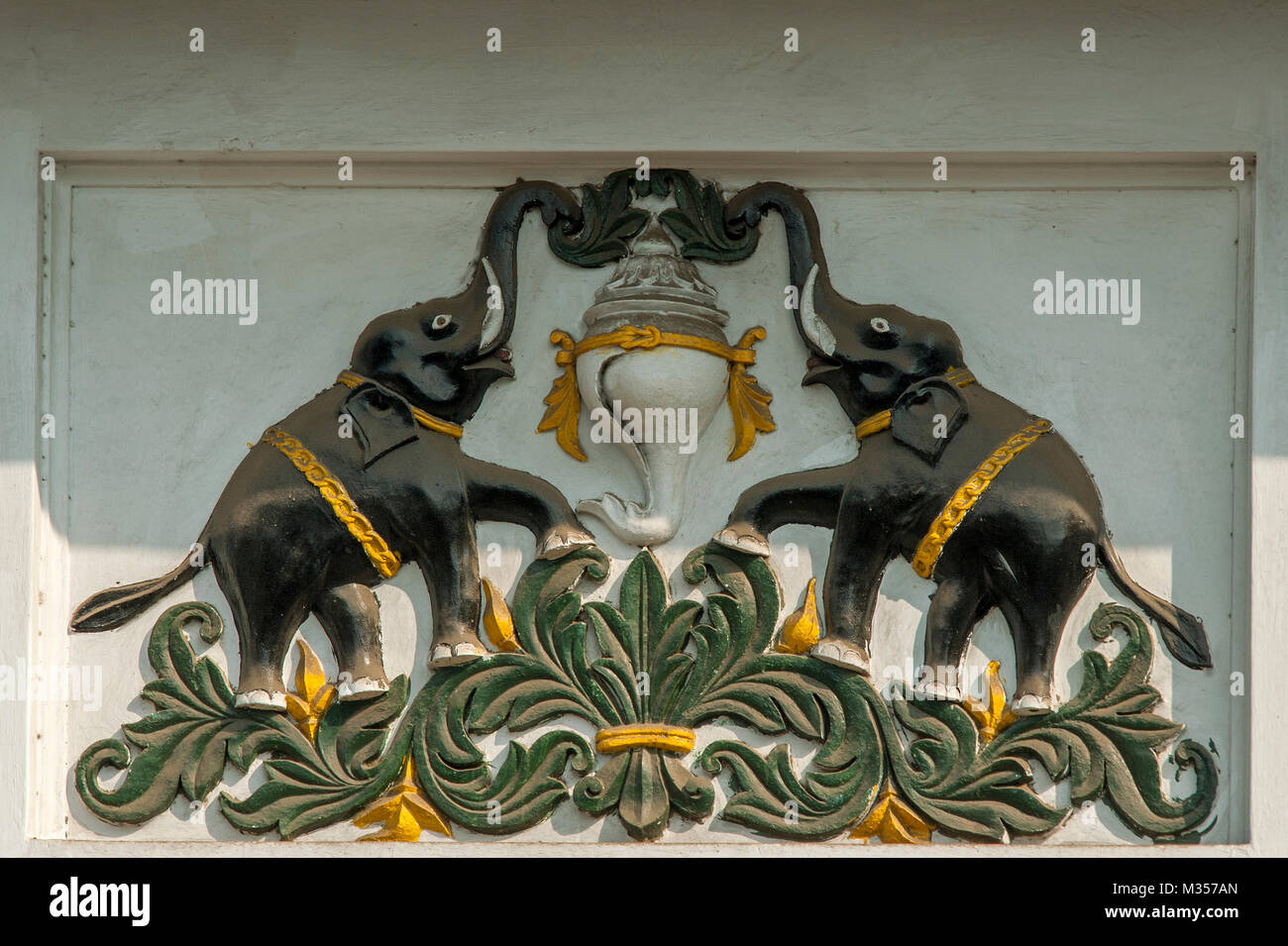 Coat of arms in stucco work, Travancore emblem, Kerala, India, Asia - Stock Image