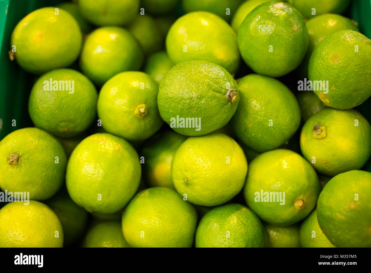 limes for sale in a supermarket - Stock Image