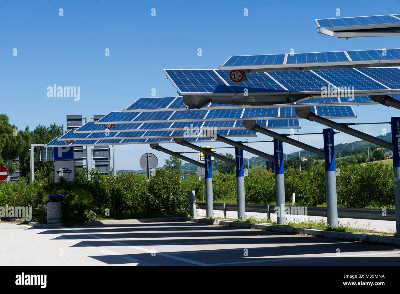 Installed solar panels on the areas of parking lot of the Italian highways - Stock Image