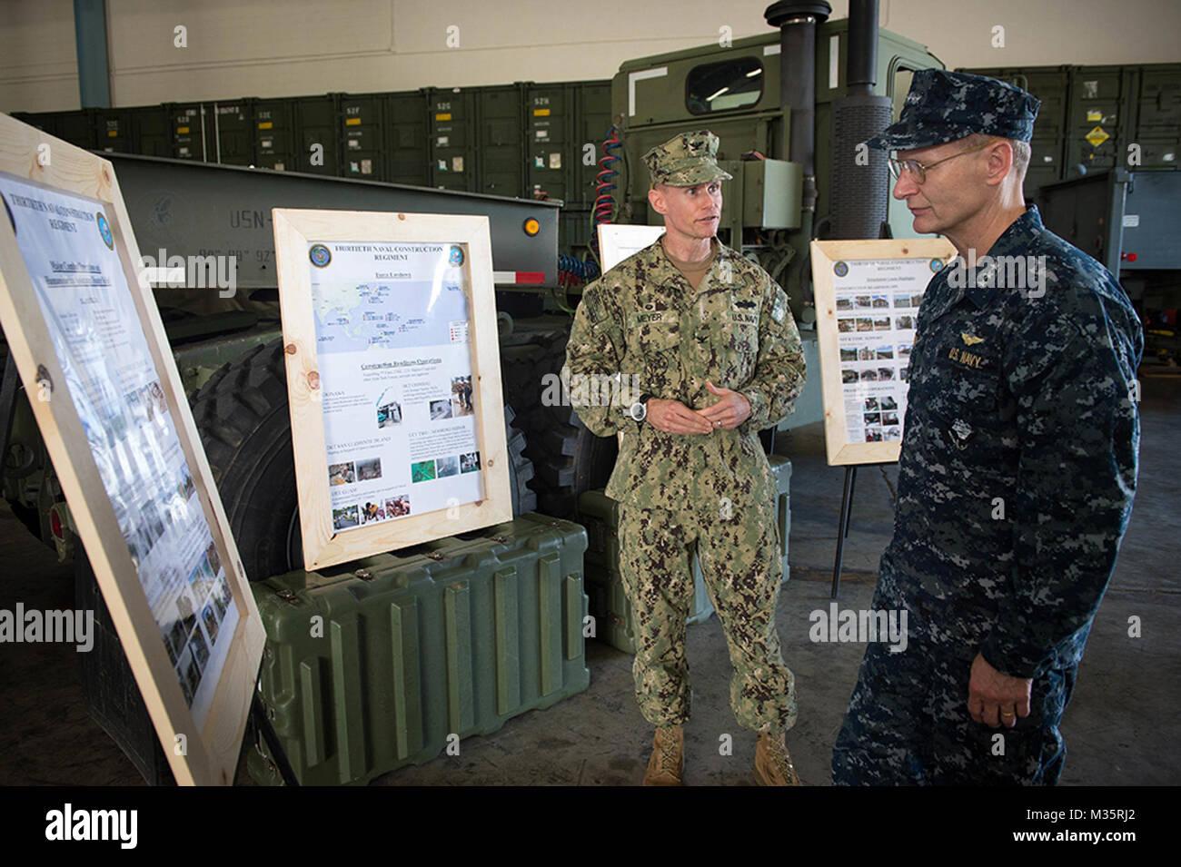 Capt. James G. Meyer, Commodore, 30th Naval Construction Regiment (NCR), briefs Vice Adm. Joseph P. Aucoin, Commander, - Stock Image