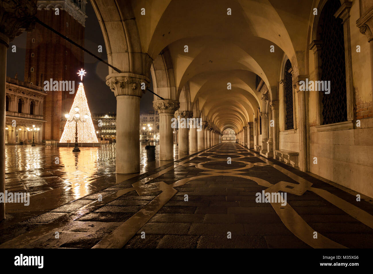 Venice Place san Marco at rainy night with wetness reflections the most famous place in Venice Italy - Stock Image