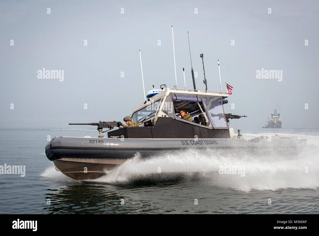 U.S. Coast Guardsmen, assigned to Port Security Unit 309 in Port Clinton, Ohio, conduct security patrols during Stock Photo