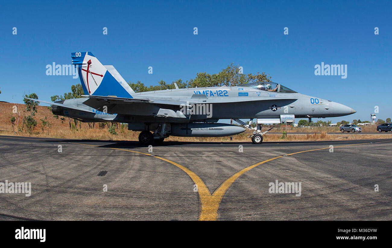 An F/A -18C Hornet with Marine Fighter Attack Squadron (VMFA)122, taxis to the runway to launch air operations during - Stock Image