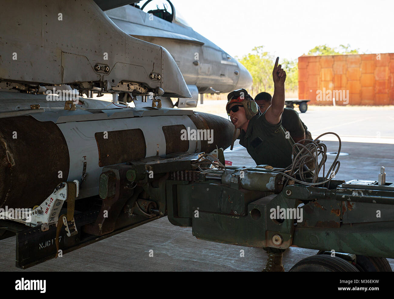 U.S. Marine Corps Lance Cpl. Trevor Serenelli, ordnance Marine assigned to Marine Fighter Attack Squadron (VMFA) - Stock Image