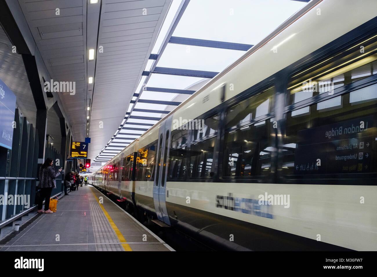 A Southeastern train passing through London Bridge station, London, UK - Stock Image