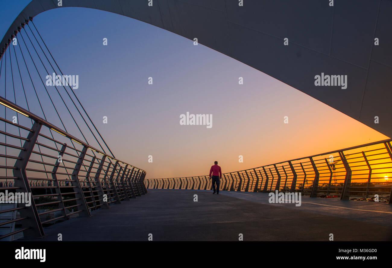 Evening shot of Dubai Water Canal Bridge New Attraction of Dubai City Tolerance Bridge - Stock Image