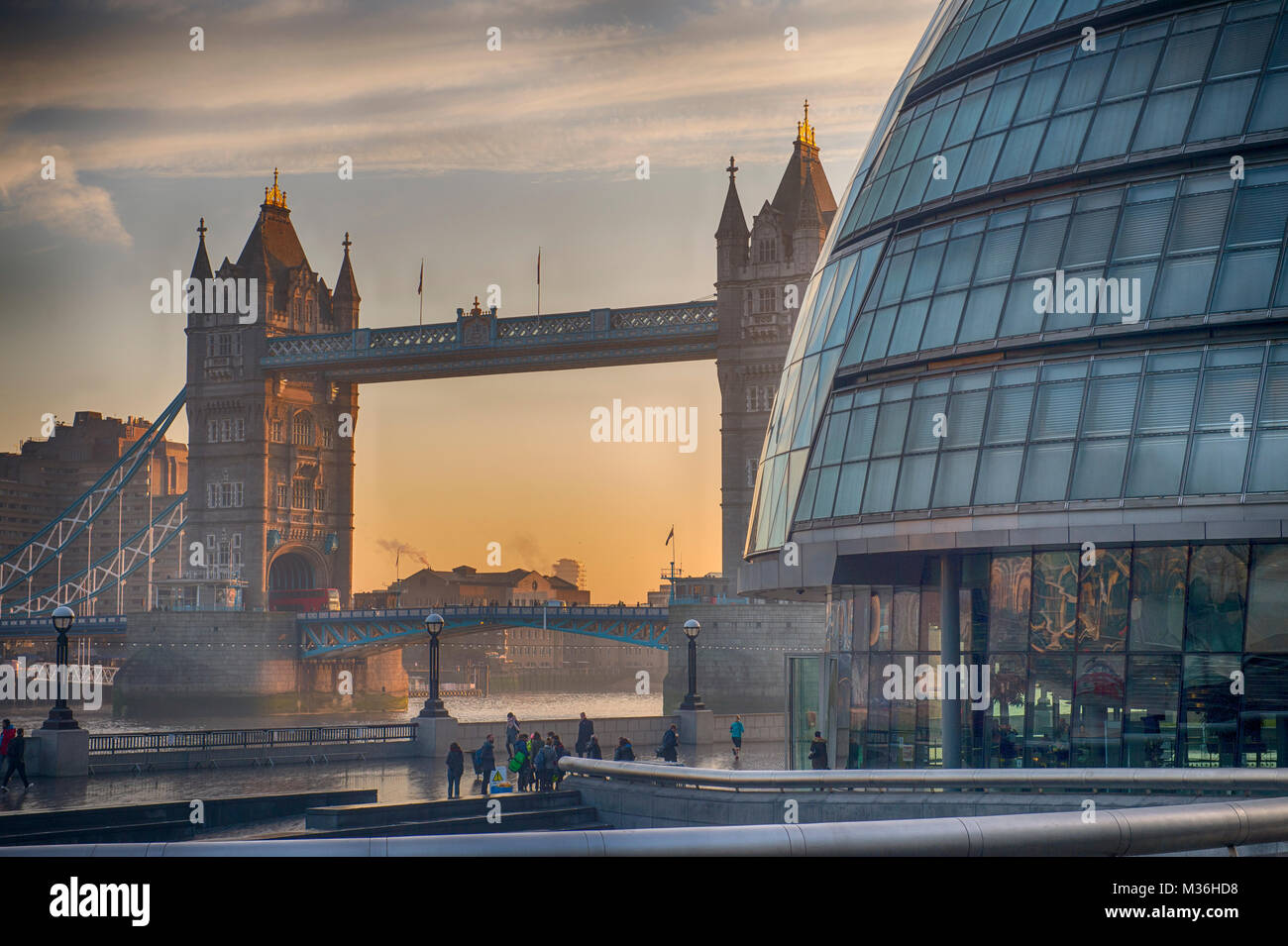 London UK. 24 Jan 2017. Dawn breaks behind Tower Bridge and the GLA building in central London. Credit: Malcolm - Stock Image
