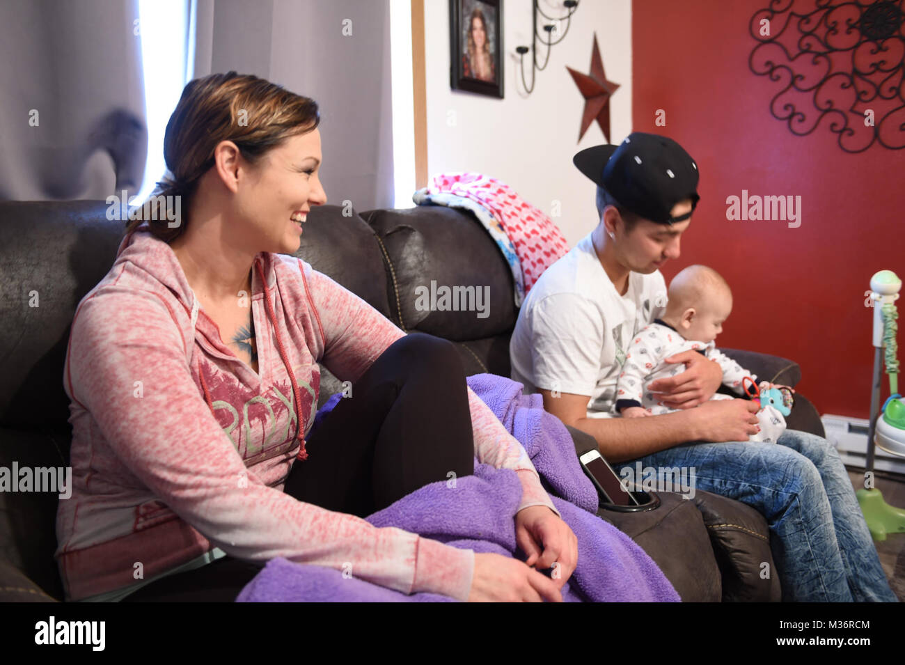 Alicia Rodriguez smiles as she talks to her son Tyger Rodriguez, 17, of Torrington, Wyoming, while he holds his - Stock Image