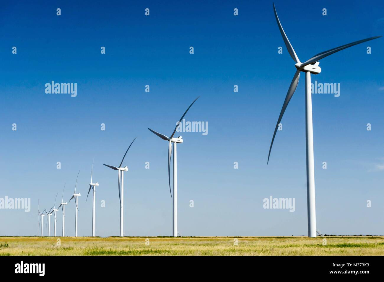 large white wind turbines on wind farm in the Texas Panhandle plains - Stock Image
