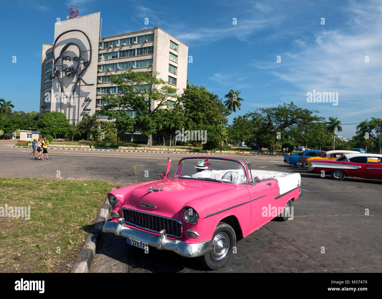 Pink 1955 Chevrolet Bel Air Convertible In Revolution Square, Havana With  Mural Of Fidel Castro