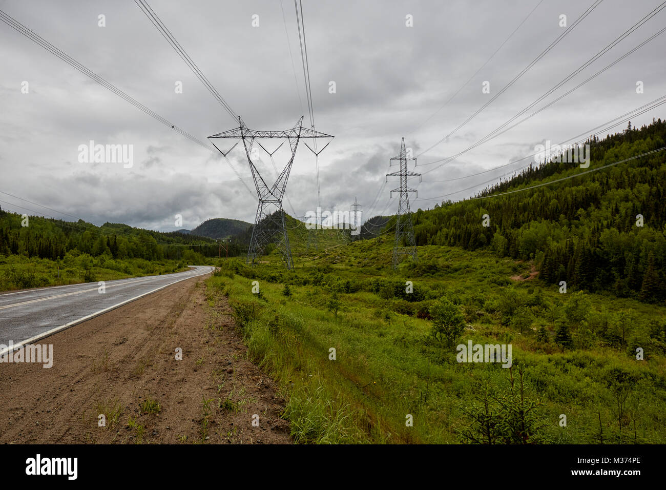 Electricity Pylons from Manic 3 on Route 389, Quebec, Canada - Stock Image