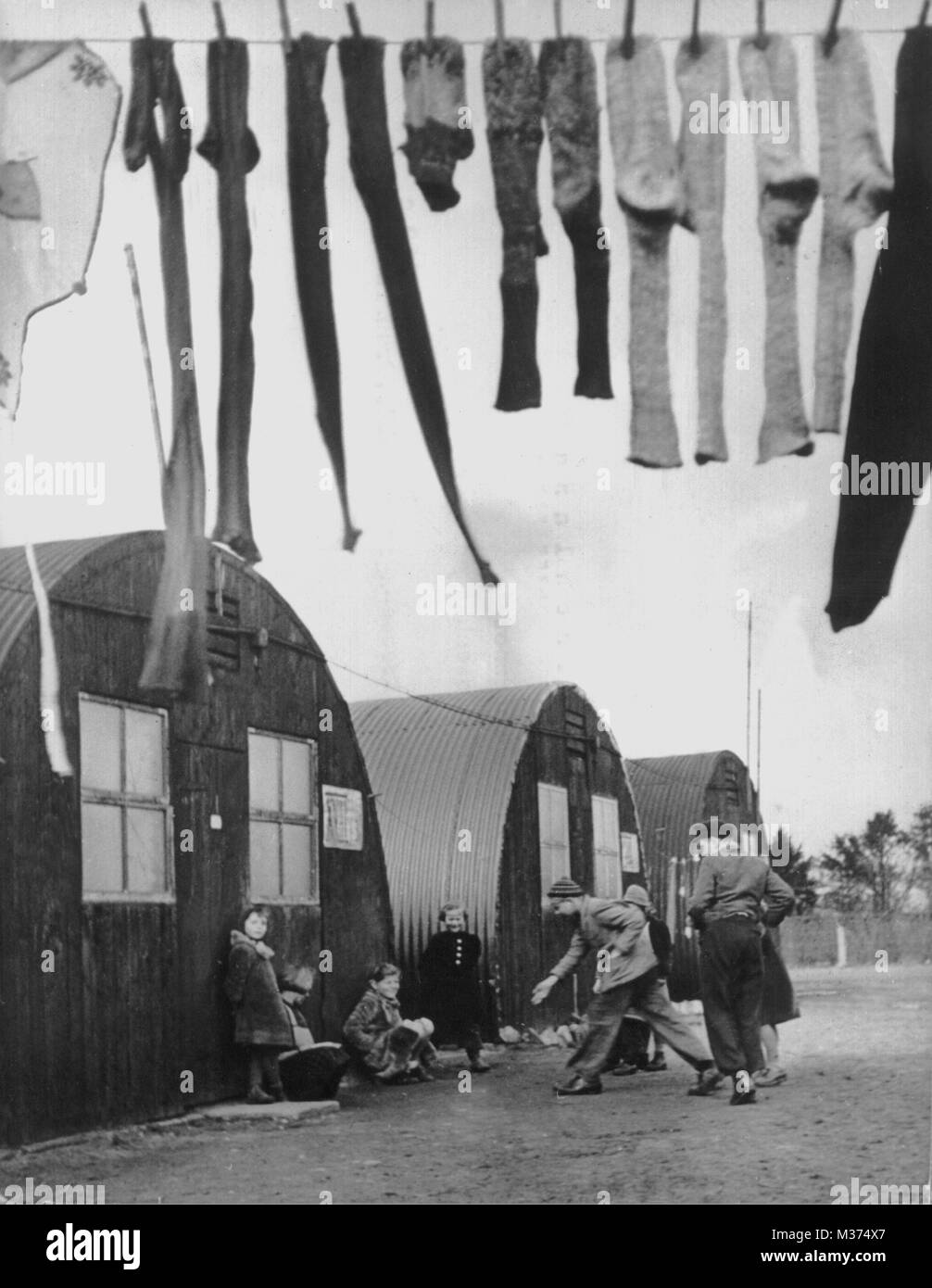 View on a row of nissen huts which have served as emergency shelter during the post-war era.   usage worldwide - Stock Image