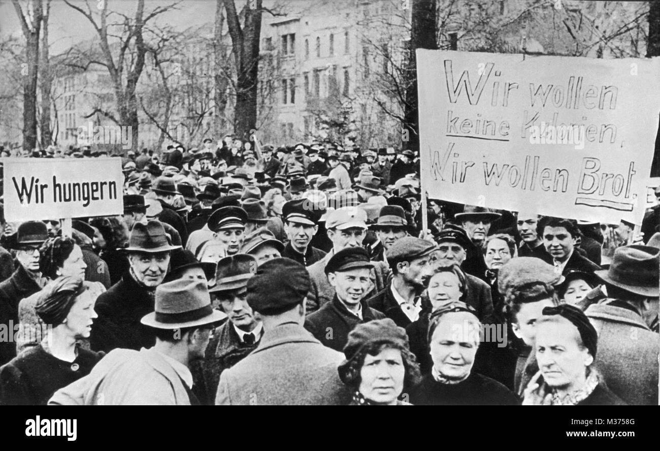 With posters 'We are starving' and 'We don't want calories. We want bread.', people are demonstrating - Stock Image