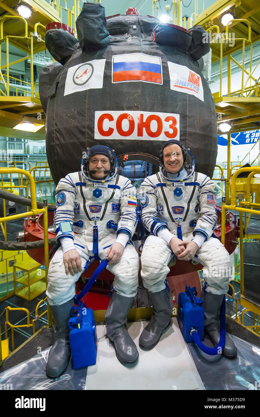 In the Integration Building at the Baikonur Cosmodrome in Kazakhstan, Expedition 51 crew members Fyodor Yurchikhin - Stock Image