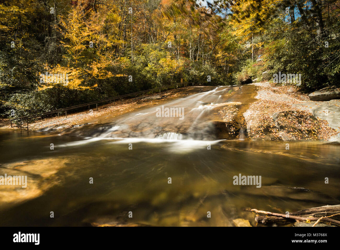 Sliding Rock Waterfall in the Appalachian mountains of western North Carolina in great fall colors Stock Photo