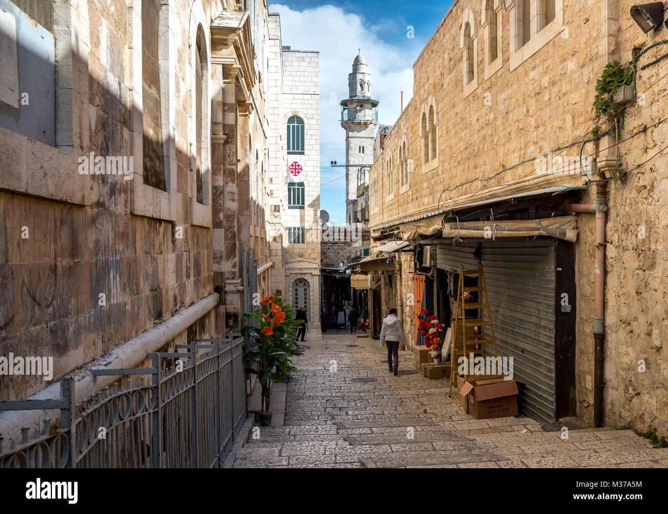Narrow street situated in Jerusalem / Al-Quds old town, Armenian christian quarter. Mosque in background,Israel. - Stock Image