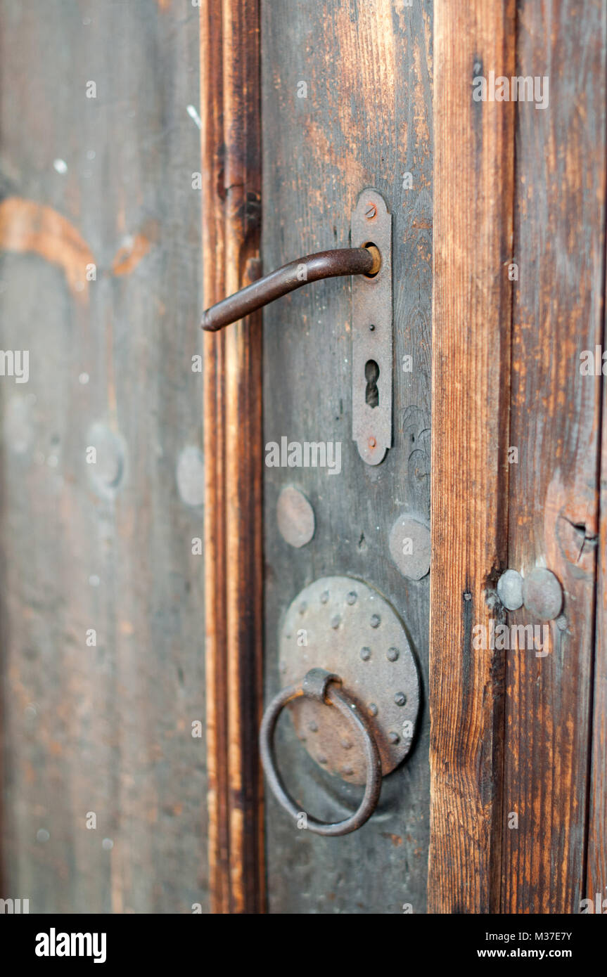 Old fashioned Rusty lock in ancient wooden door Stock Photo